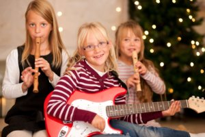 Young children with guitars and flutes